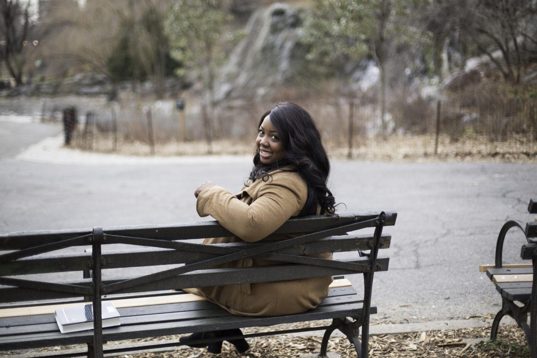 Sade sitting on park bench