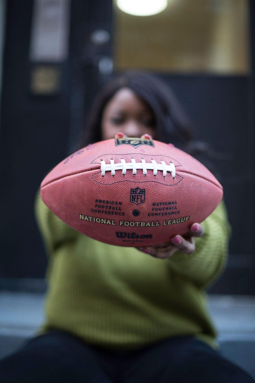 sade holding a football